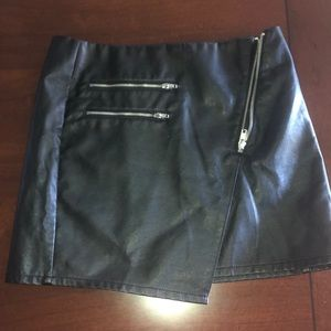 Black faux leather asymmetrical skirt with zipper